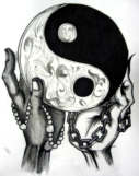 yin-yang-symbol-in-hands-tattoo-design